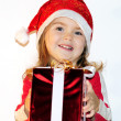 The little girl in a New Year's hat with a gift — Stock Photo #8020315