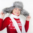 The young beautiful cheerful girl in a fur cap to a cap with ear-flaps — Stock Photo