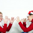 Two young beautiful girls play a white background — Stock Photo #8020733