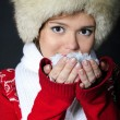 The young beautiful girl in a fur cap has control over snow — Stock Photo #8020780
