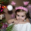 The small beautiful girl with wings near a New Year tree — Stock Photo