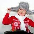 The young beautiful cheerful girl in a fur cap to a cap with ear-flaps — Stock Photo #8175185
