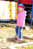 The little girl walks in autumn park — Stock Photo