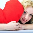Beautiful girl blonde with red heart in hand — Fotografia Stock  #8573018