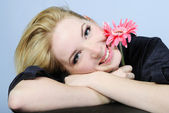 Portrait of the young beautiful girl with flower — Stock Photo