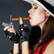 Beautiful bright girl with cigar — Stock Photo