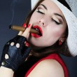 Stock Photo: Beautiful bright girl with cigar