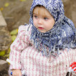 The little girl in a dark blue kerchief plays sand — Stock Photo #8861546