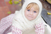 Portrait of the small beautiful girl in a white scarf kerchief — Stock Photo