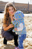 The young beautiful girl with the small child at the sea — Stock Photo
