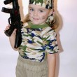 Small beautiful girl in military cloth with automaton — Stock Photo