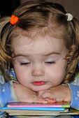 Small beautiful girl fell asleep on book — Stock Photo