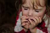 The small beautiful girl sneezes — Stock Photo