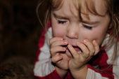 The small beautiful girl sneezes — Stock Photo