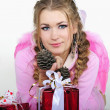 The young beautiful girl an angel with gifts - Stock Photo