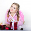 The young beautiful girl an angel with gifts — Stock Photo #9402405