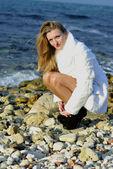 The young beautiful girl near the sea — Stock Photo