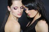 Two beautiful stylish fashionable girls to models — Stock Photo