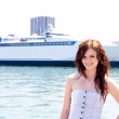 The girl on the background of the ocean liner — Stock Photo #10514898
