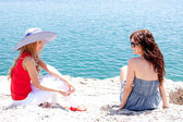 Two girls at the seaside — Stock Photo