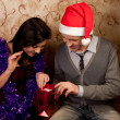 A couple celebrates Christmas — Stock Photo #8581369