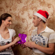 A couple celebrates Christmas — Stock Photo