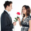 Man gives a woman flowers — Stock Photo #8774575