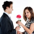 Man gives a woman flowers — Stock Photo #8774597