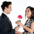 Man gives a woman flowers — Stock Photo #8774600
