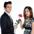 Man gives a woman flowers — Stock Photo