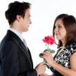 Man gives a woman flowers — Stock Photo #8774605