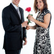 Man gives a woman flowers — Stock Photo #8774609