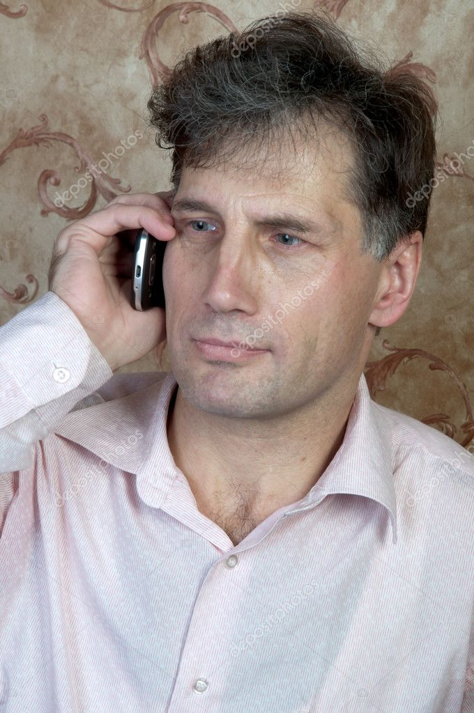 Portrait of middle-aged men talking on the telephone at home — Stock Photo #8936126