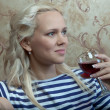 A girl with a glass of wine — Stock Photo #9213686