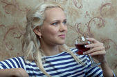 A girl with a glass of wine — Stock Photo