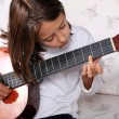 Young girl play classical guitar — Stock Photo
