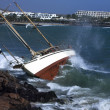Yacht crash on the rocks in stirmy weather — Stock Photo