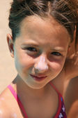 Girl with sunscreen in her nouse — Stock Photo