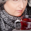 Woman with teacup — Stock Photo