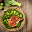 Chicken's thigh in the vegetable - Stock Photo