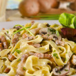 Stock Photo: Tagliatelle with tail steak stripe and champignons