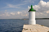 Lighthouse on the pier. — Stock Photo