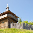 Stock Photo: Modern reconstruction of watchtower and wooden ramparts of fortress