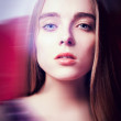 Close-up portrait of young beautiful woman with blur — Stock Photo #10049766