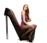 Young woman sitting on the shoes chair — Stock Photo