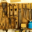 Assortment of do it yourself tools hanging in a wooden cupboard against a wall — Stock Photo
