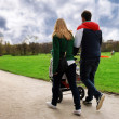 Stock Photo: Family walking in park road