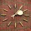 A large clock on the brick wall - Stock Photo