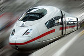 Modern Fast Passenger Commuter Train in the Station with Motion Blur — Stock Photo