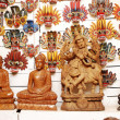 Traditional masks and buddha statue of the devil at the shop — Stock Photo